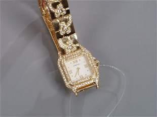 CARTIER - a lady's 18ct gold diamond se