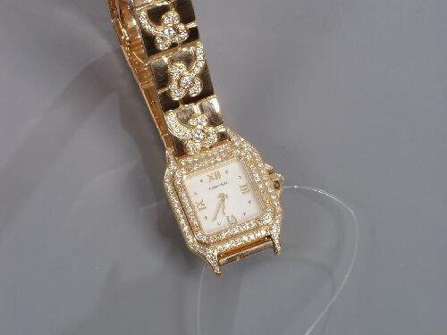 2009: CARTIER - a lady's 18ct gold diamond se