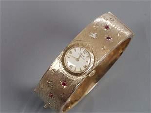 GIRARD PERREGAUX - a lady's 9ct gold ma