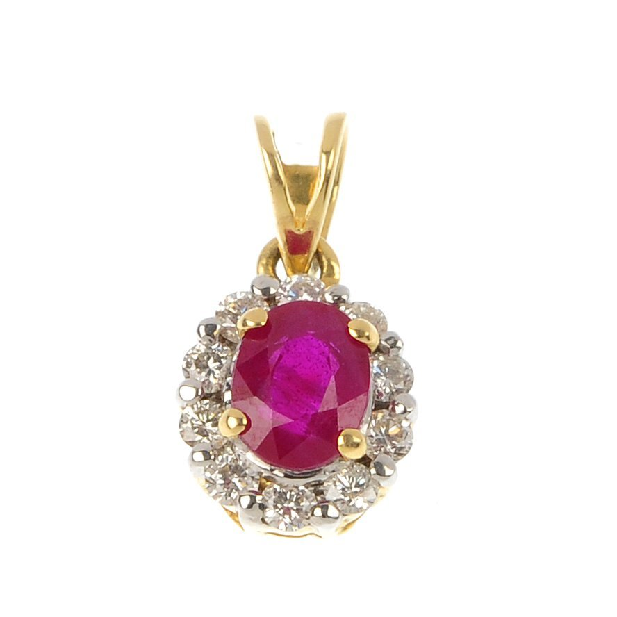 A ruby and diamond pendant.