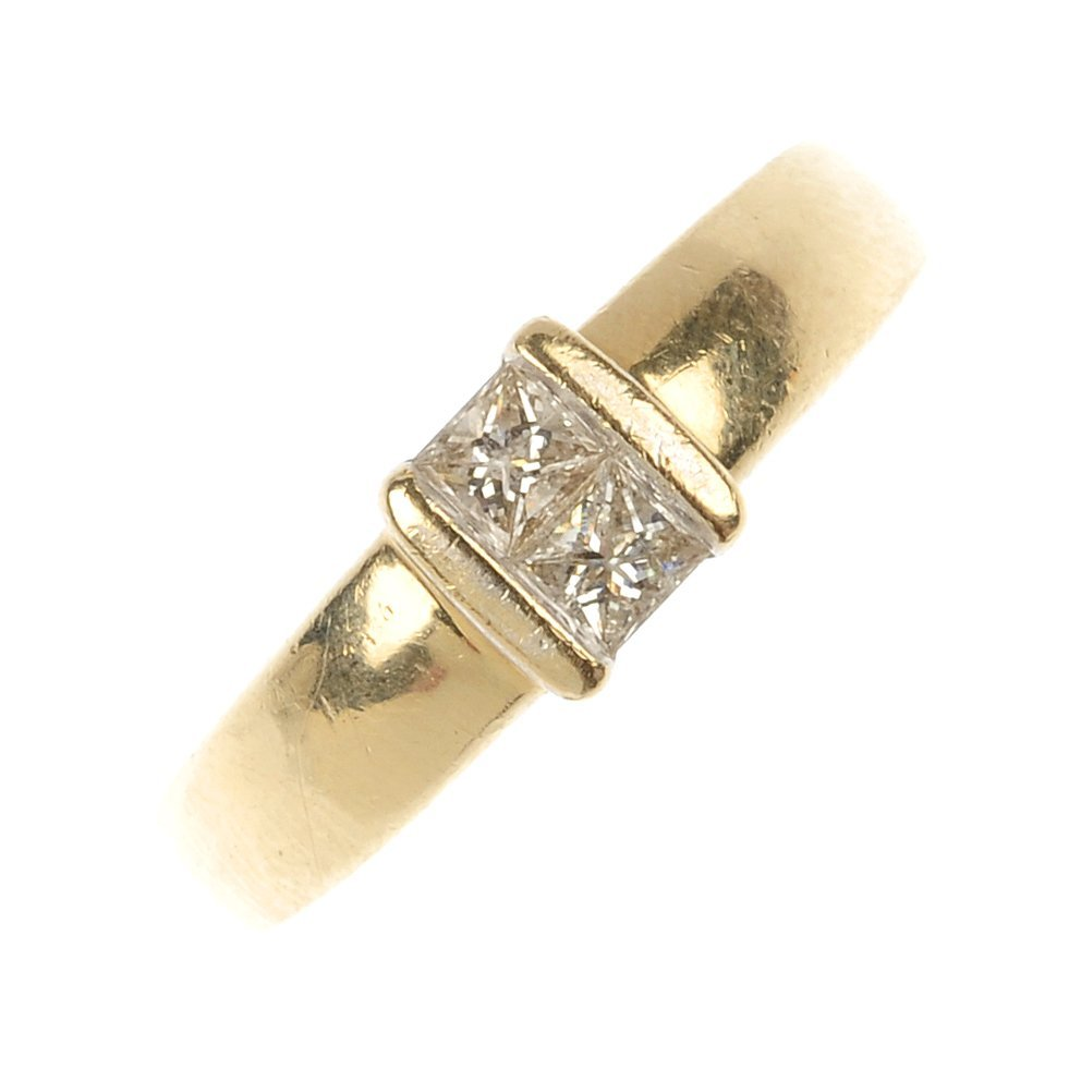 A 9ct gold diamond two-stone ring.