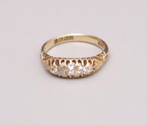 1004: 18ct gold five stone old cut diamond bo