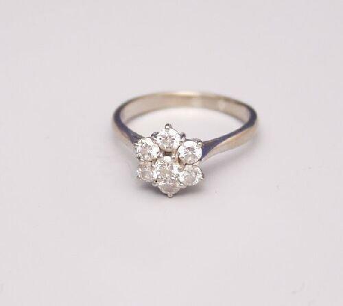 1012: 18ct white gold all diamond seven stone