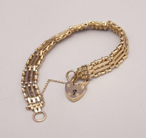 1020: Edwardian 9ct gold decorative four bar