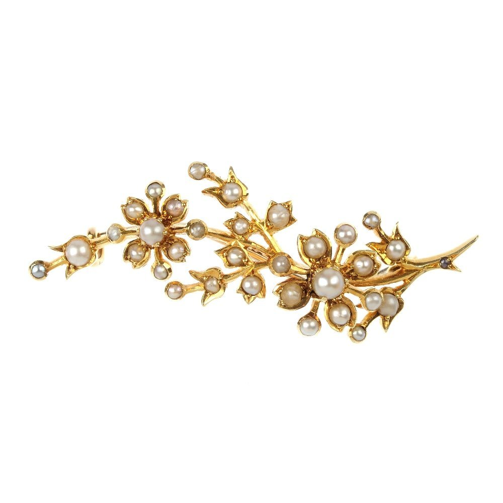 An early 20th century 15ct gold split pearl brooch.
