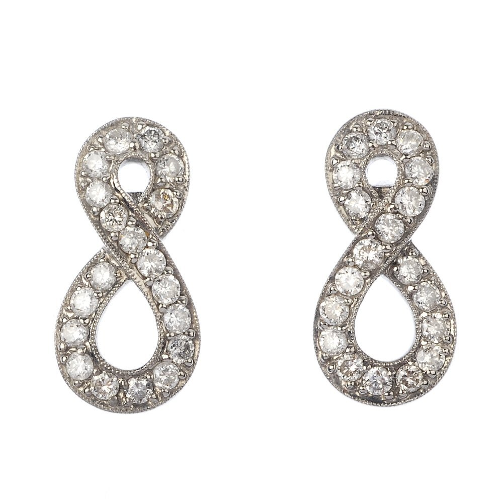 A pair of diamond ear pendants.