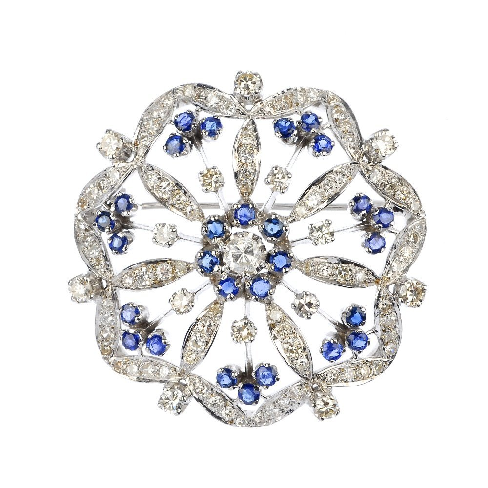 A sapphire and diamond floral brooch.