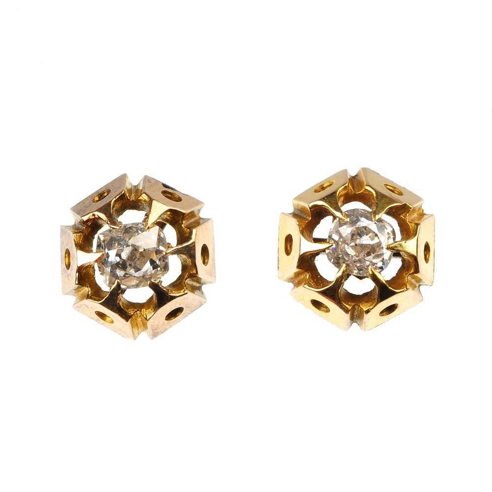 A pair of diamond single-stone ear studs.