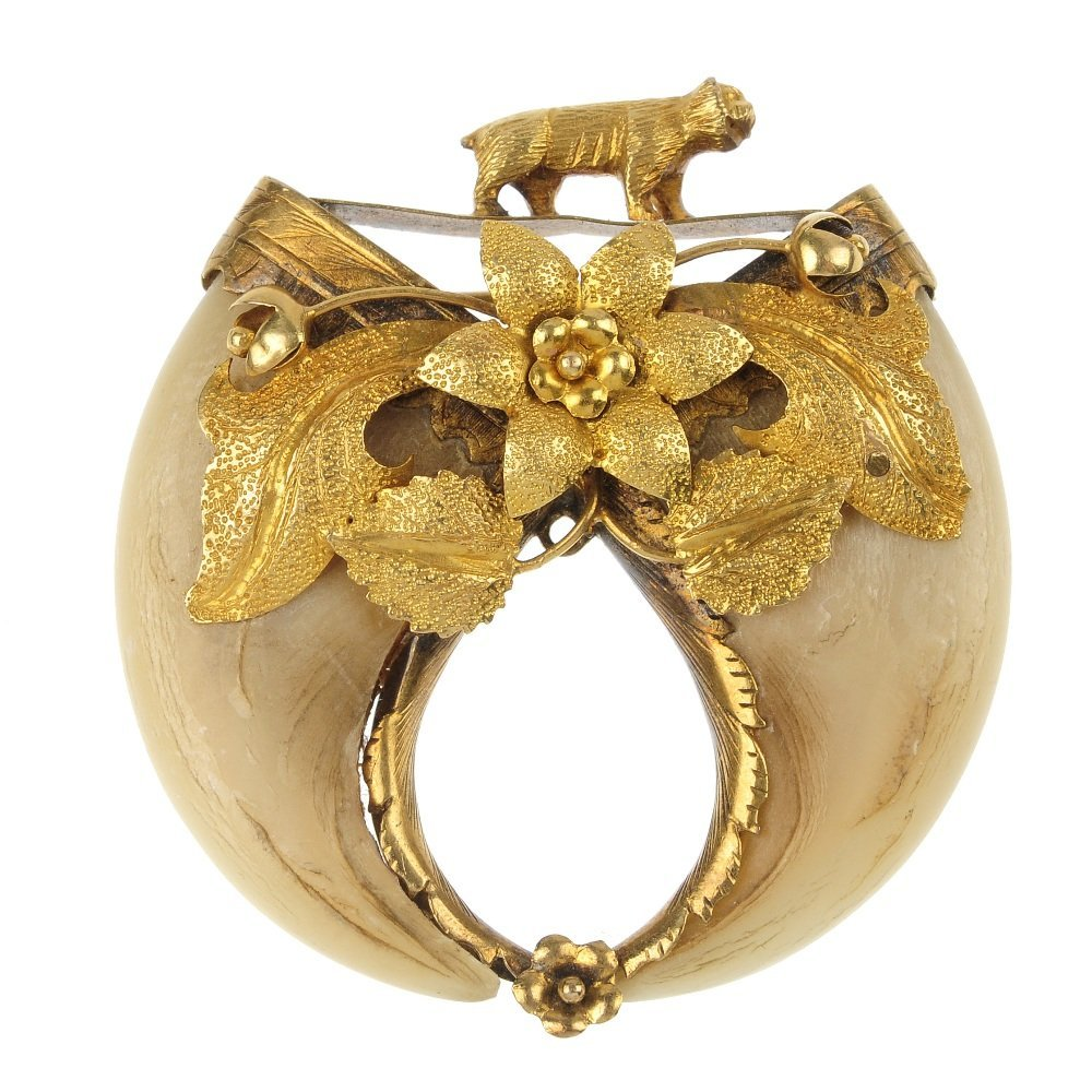 A late 19th century gold tiger claw brooch.