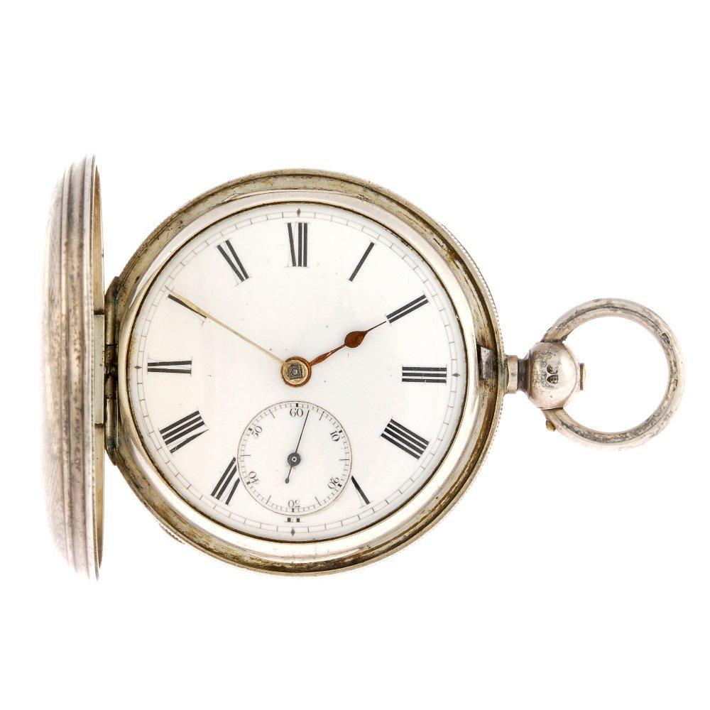 A silver full hunter key wind pocket watch.