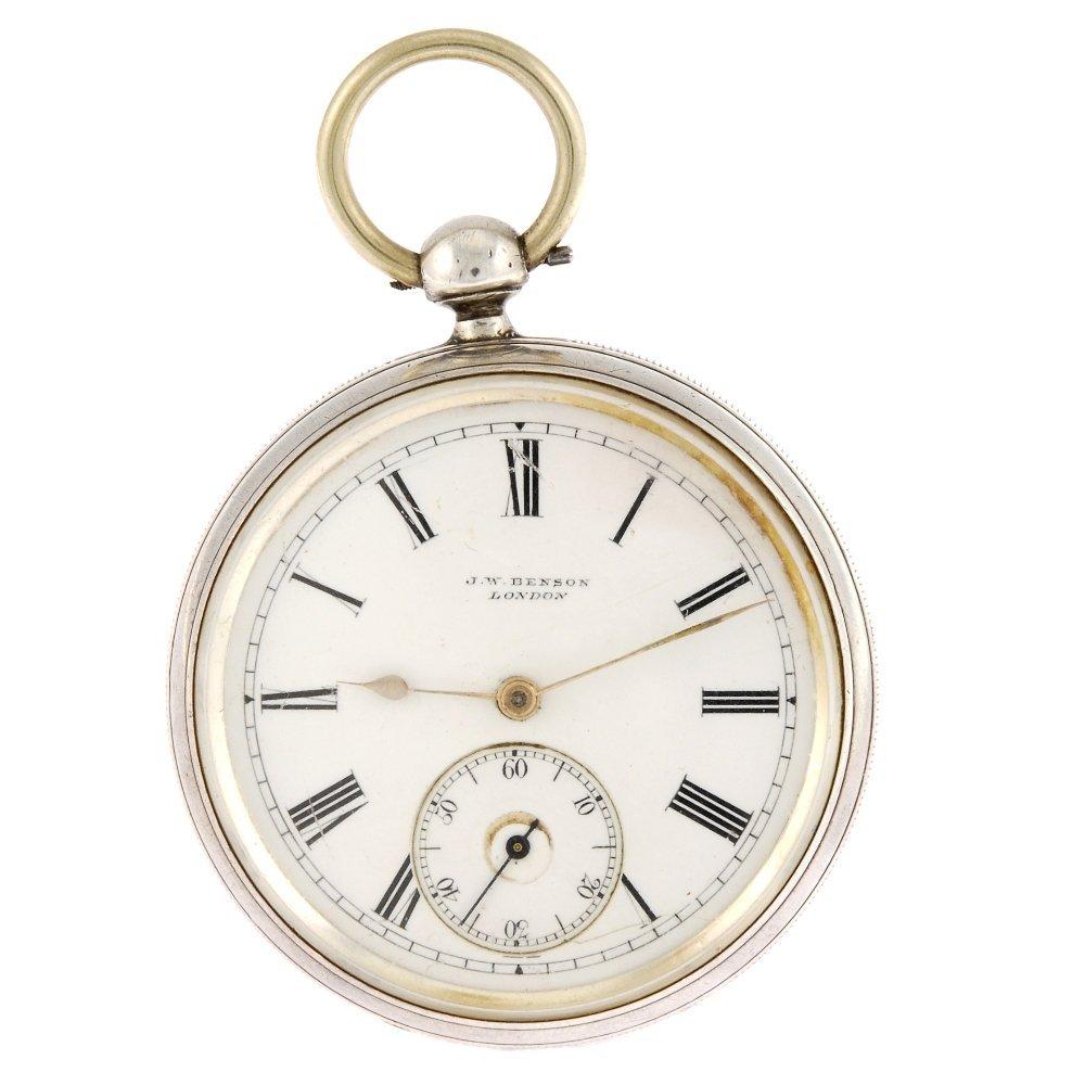A silver key wind open face pocket watch.