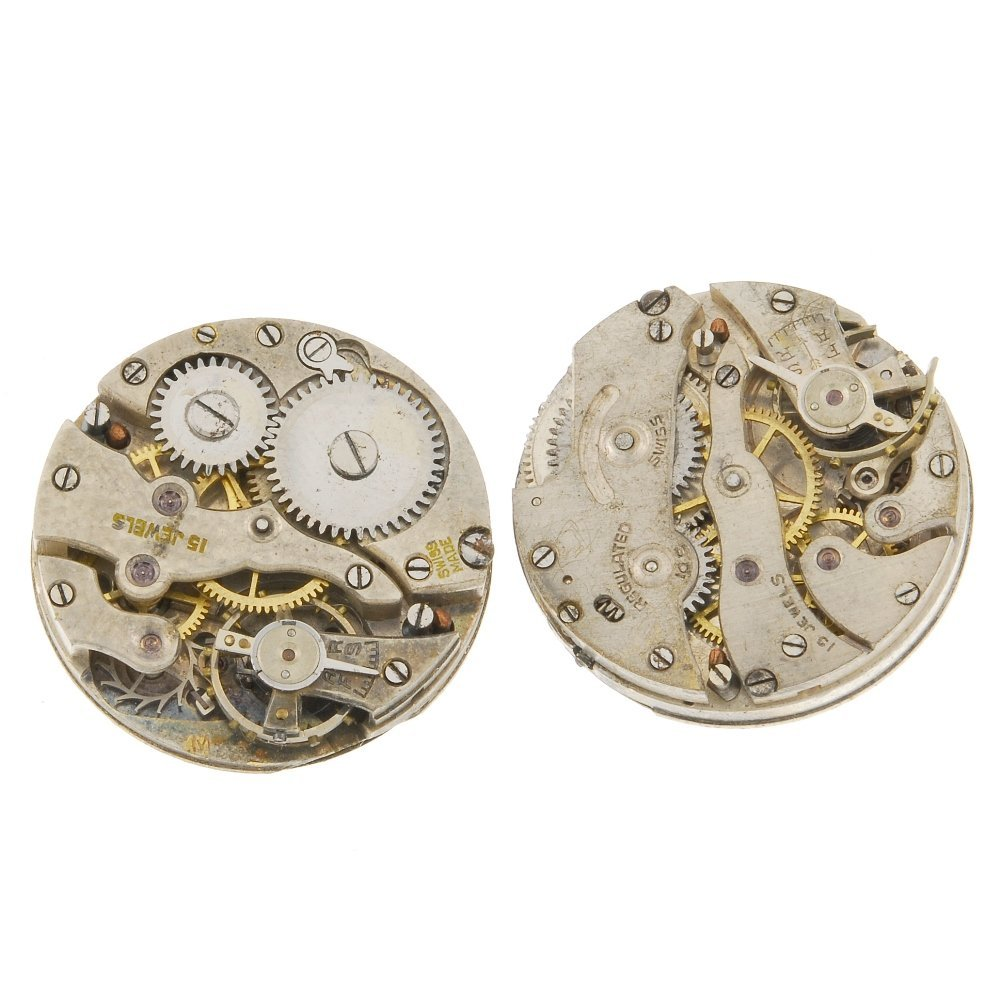 A group of watch movements and parts.