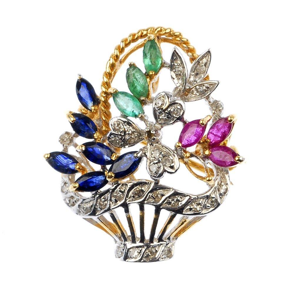 A gem-set floral brooch.