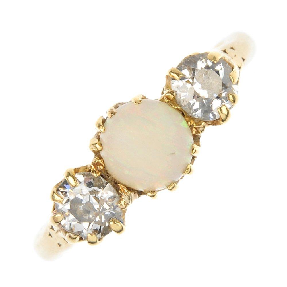 An opal and diamond three-stone ring.