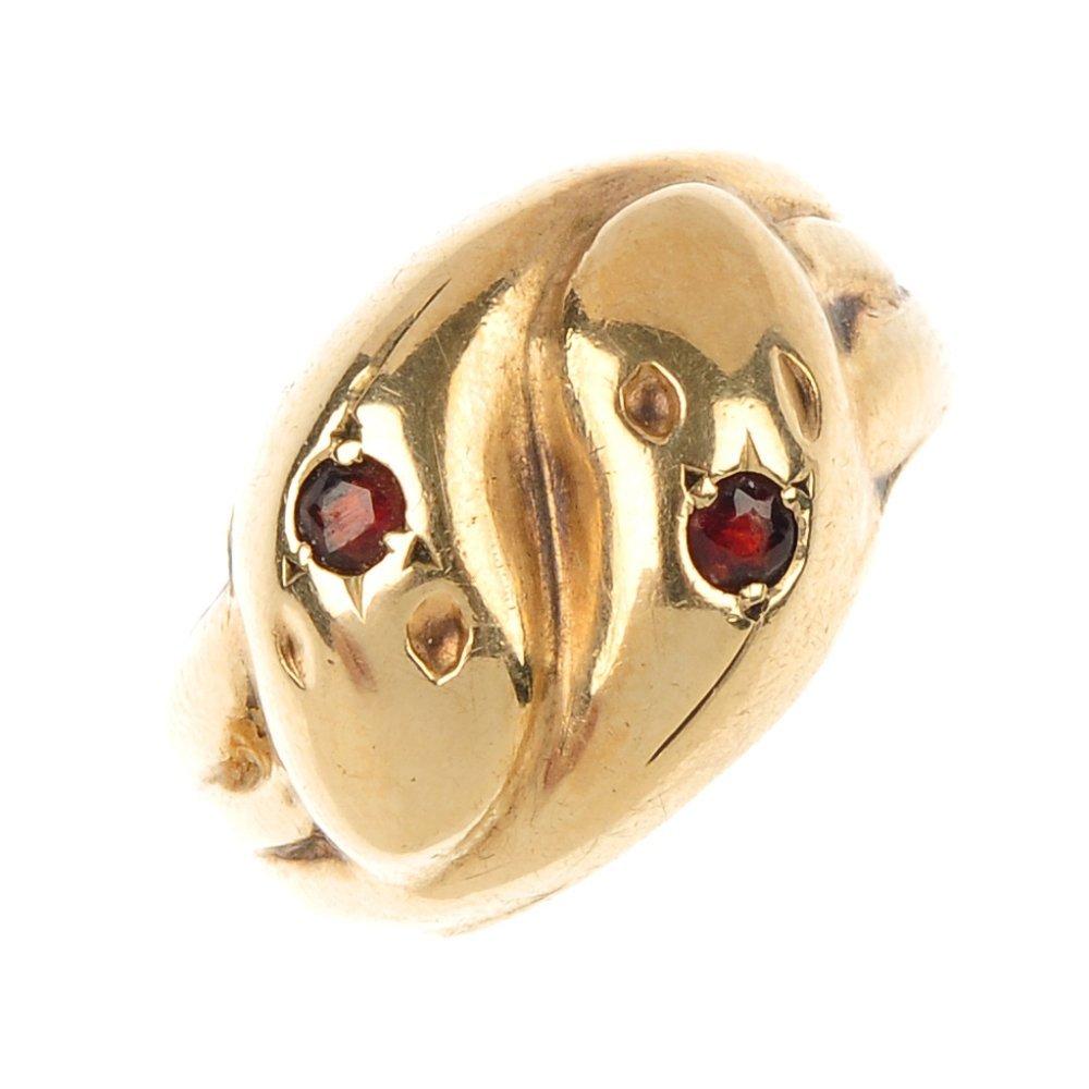 A 9ct gold garnet snake ring.