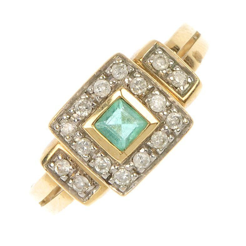 A 9ct gold emerald and diamond ring.