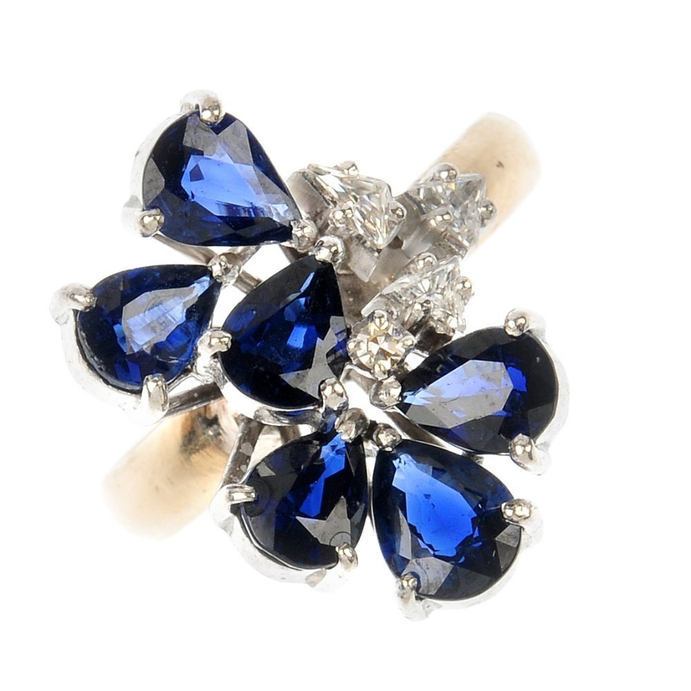 A sapphire and diamond ring cluster ring.