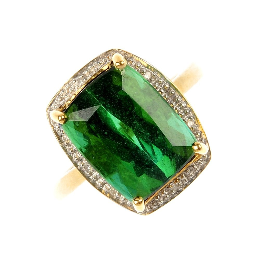 An 18ct gold tourmaline and diamond cluster ring.