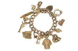 An early 20th century 9ct gold charm bracelet.