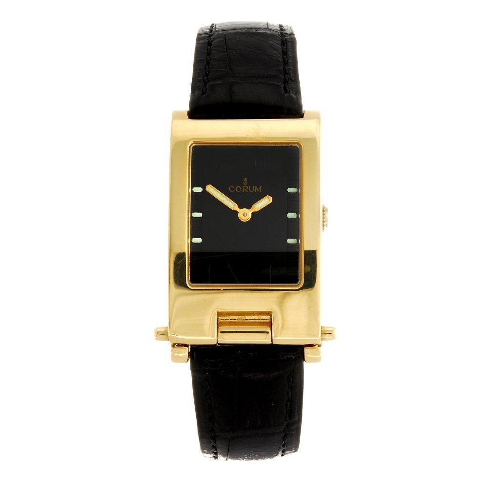 (1502-1-A) An 18k gold quartz Corum wrist watch.