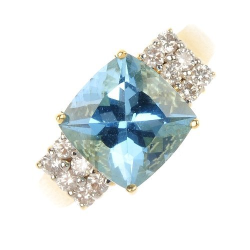 An 18ct gold aquamarine and diamond dress ring.