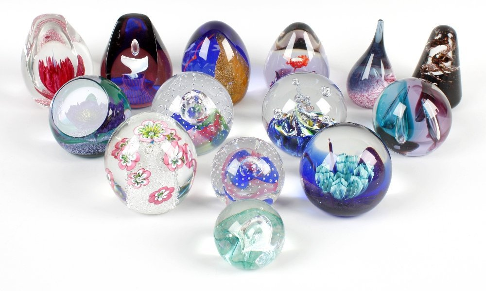 Fourteen Caithness glass paperweights