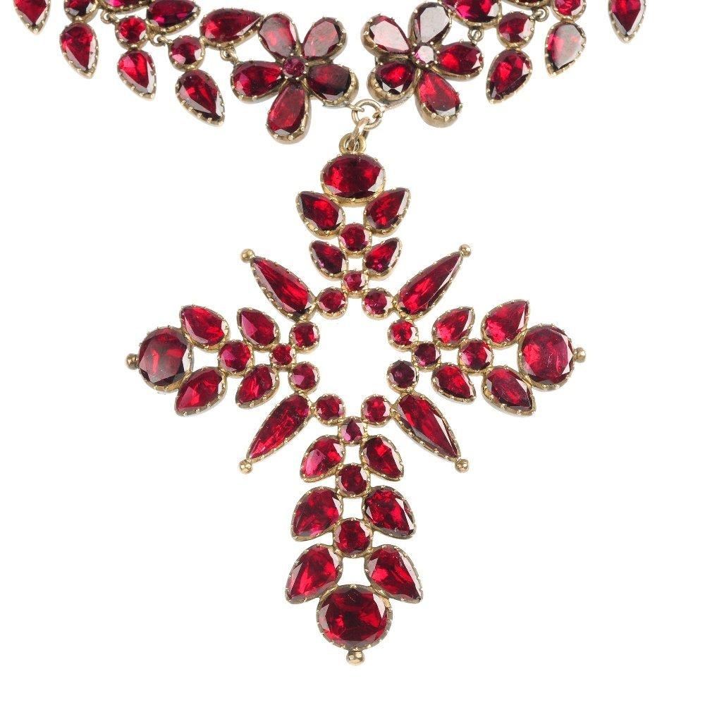 An early 19th century garnet cross pendant and necklace