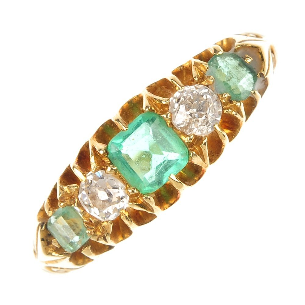 An Edwardian 18ct gold emerald and diamond ring.