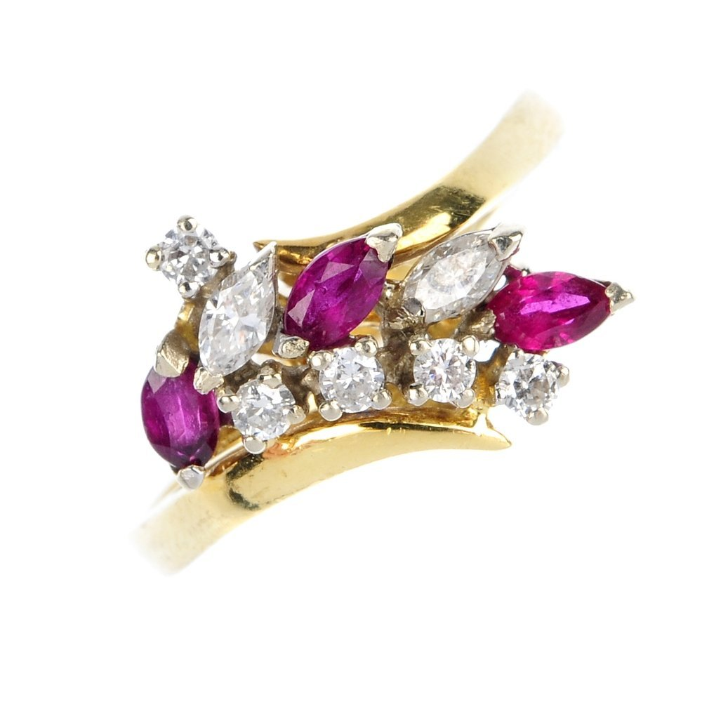 An 18ct gold ruby and diamond cluster ring.