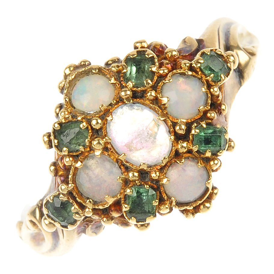 An emerald and opal cluster ring.