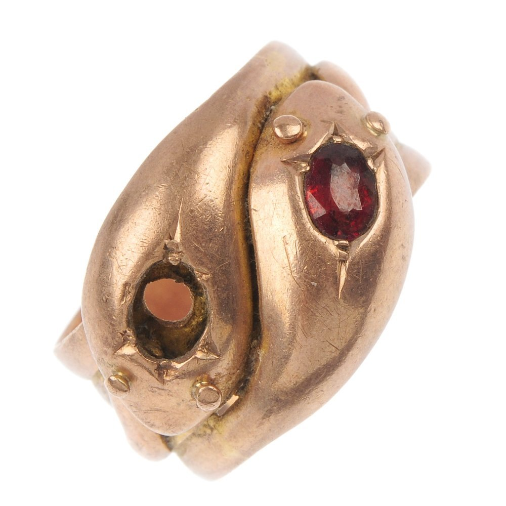 Two early 20th century 9ct gold garnet snake rings.