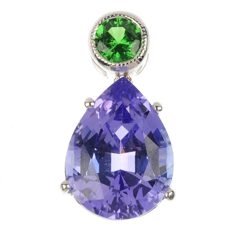 A tanzanite and tsavorite garnet pendant.