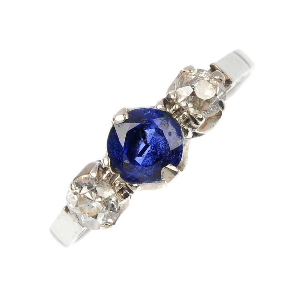 A mid 20th century platinum sapphire and diamond three-