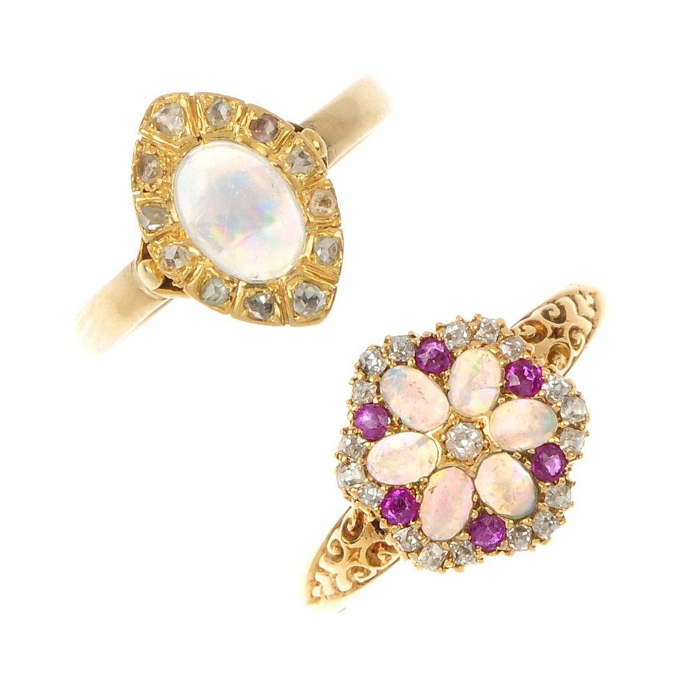 Two gold diamond and gem-set rings.