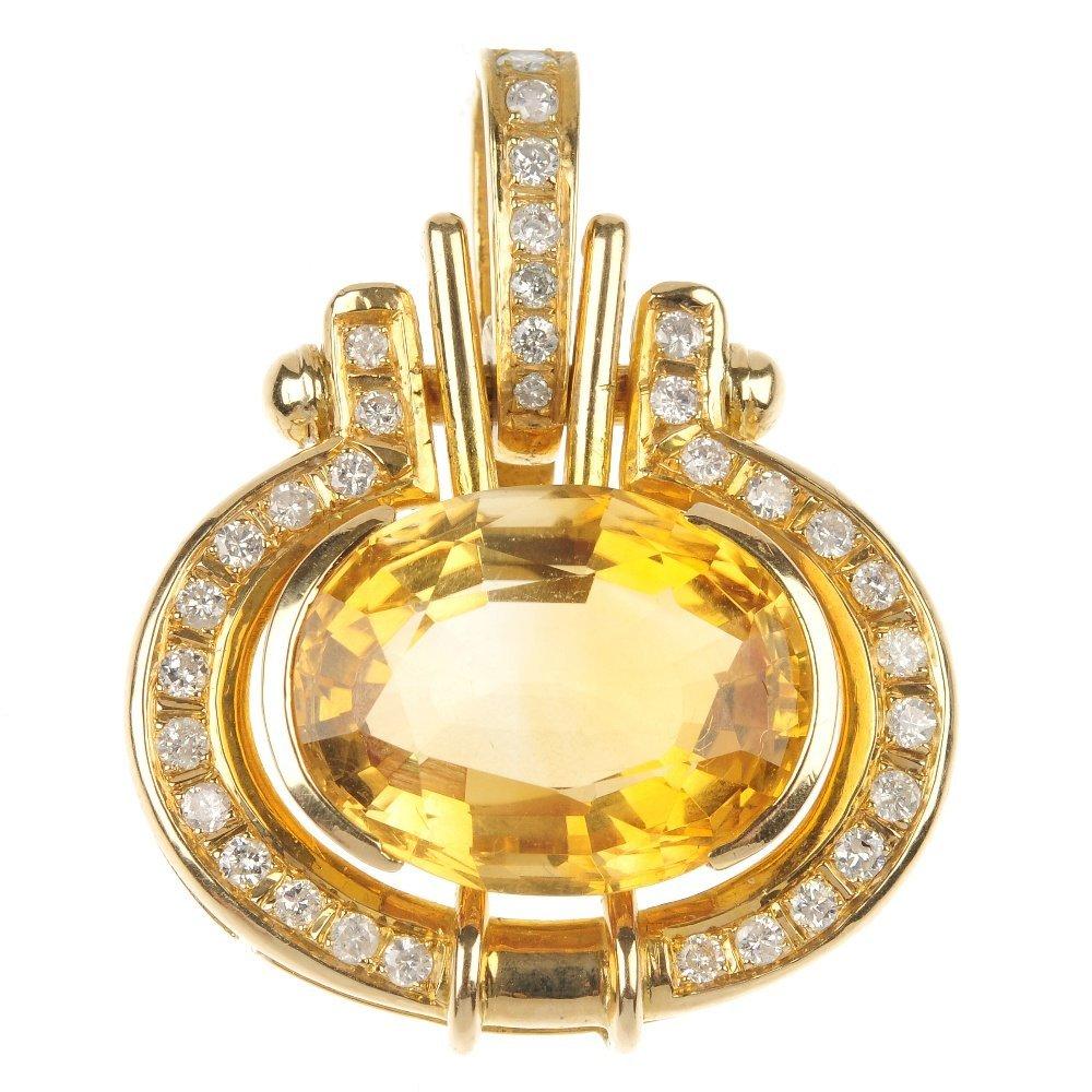 A citrine and diamond pendant.