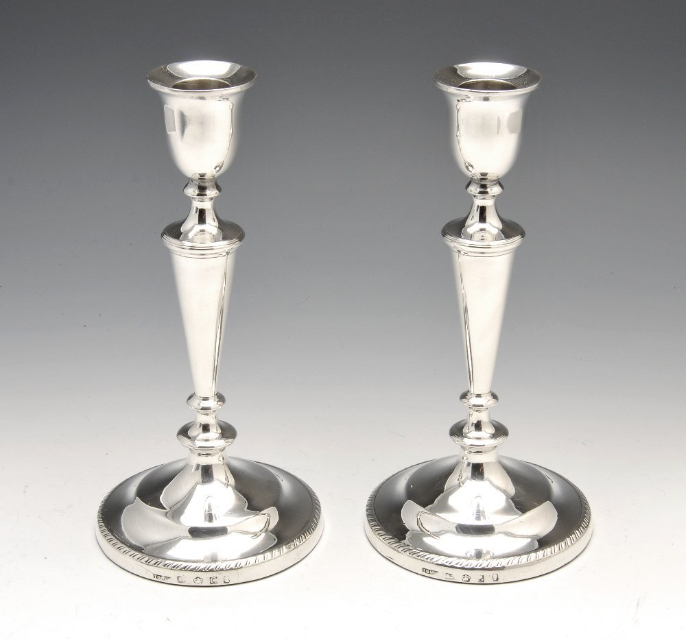 A pair of George III silver candlesticks.