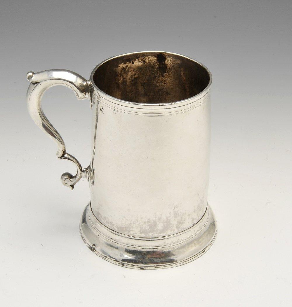 A George III Newcastle silver mug.