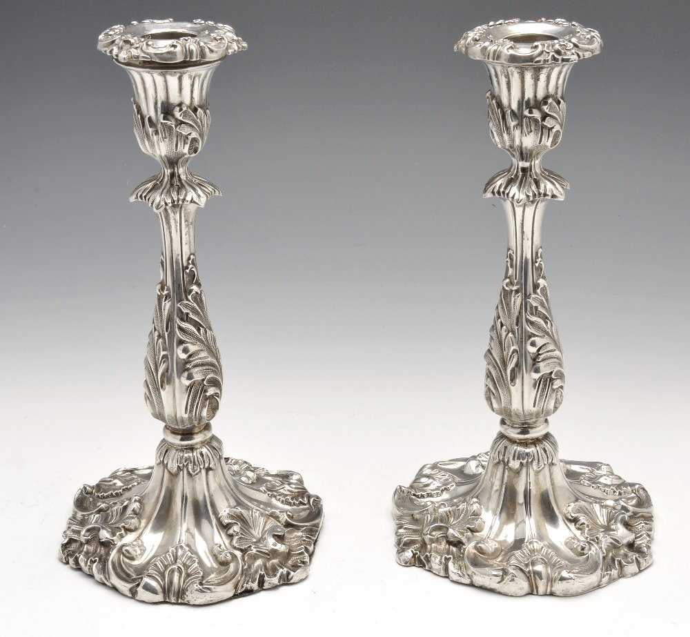 A Victorian pair of silver candlesticks.