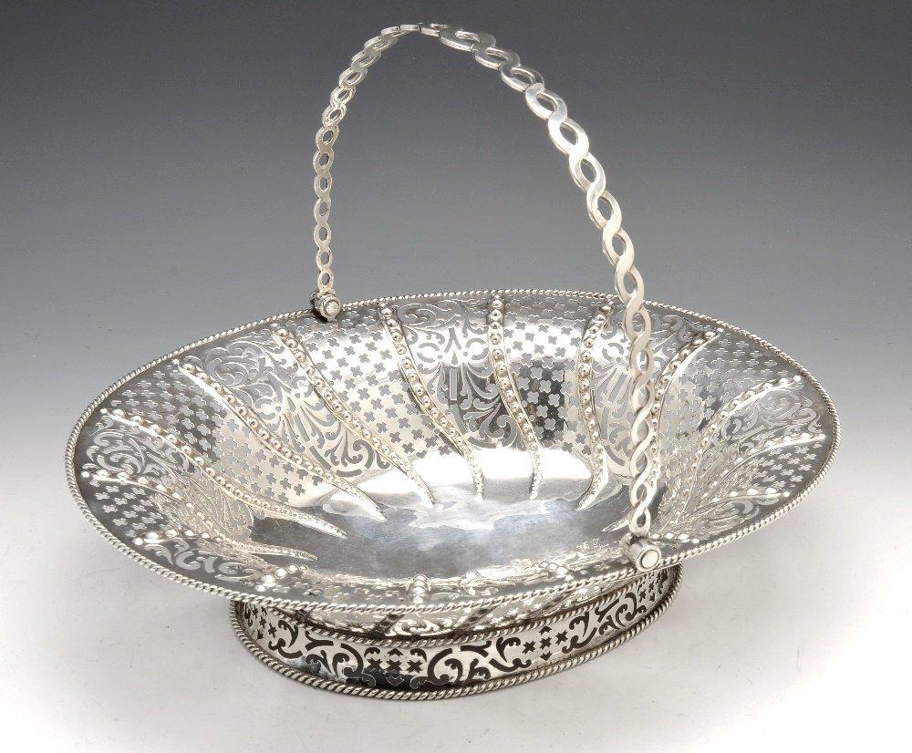 A George II silver bread basket.