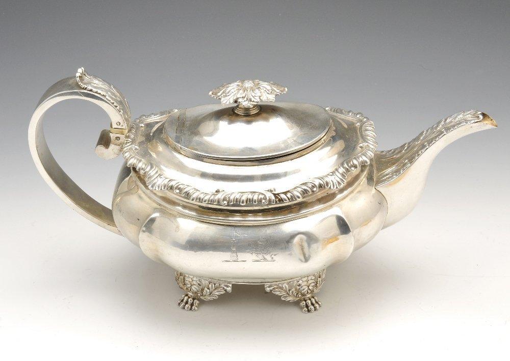 A George IV silver teapot.