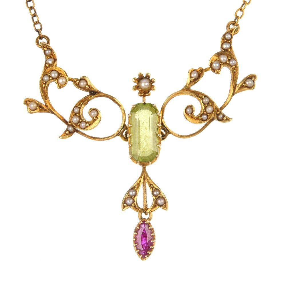 An early 20th century 15ct gold split pearl and gem