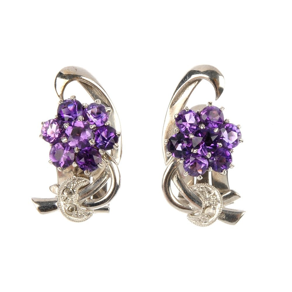 A pair of amethyst and diamond floral ear clips.