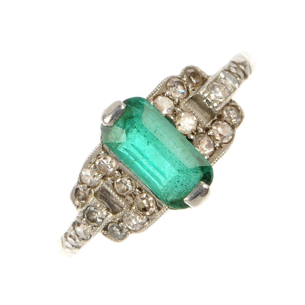 A mid 20th century platinum emerald and diamond ring.