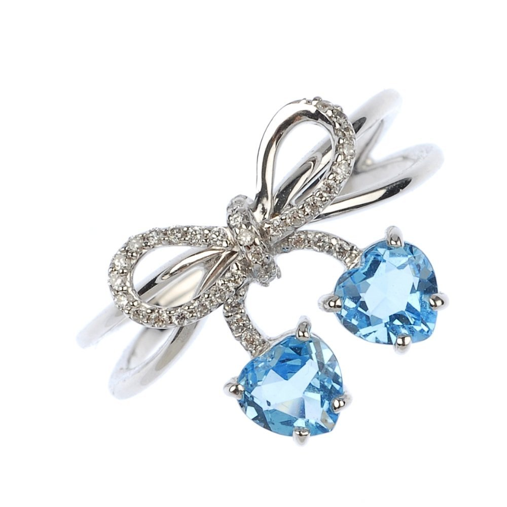 An 18ct gold diamond and topaz stylised bow ring.