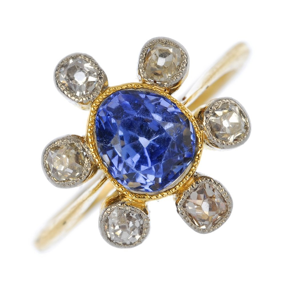 A mid 20th century gold sapphire and diamond cluster ri