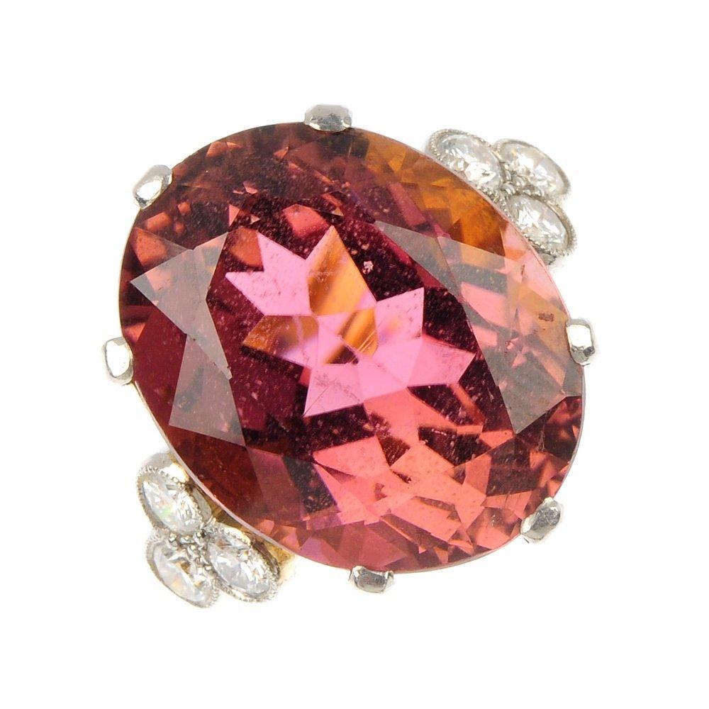 A tourmaline and diamond ring.