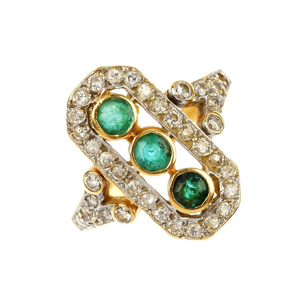 An 18ct gold emerald and diamond dress ring.