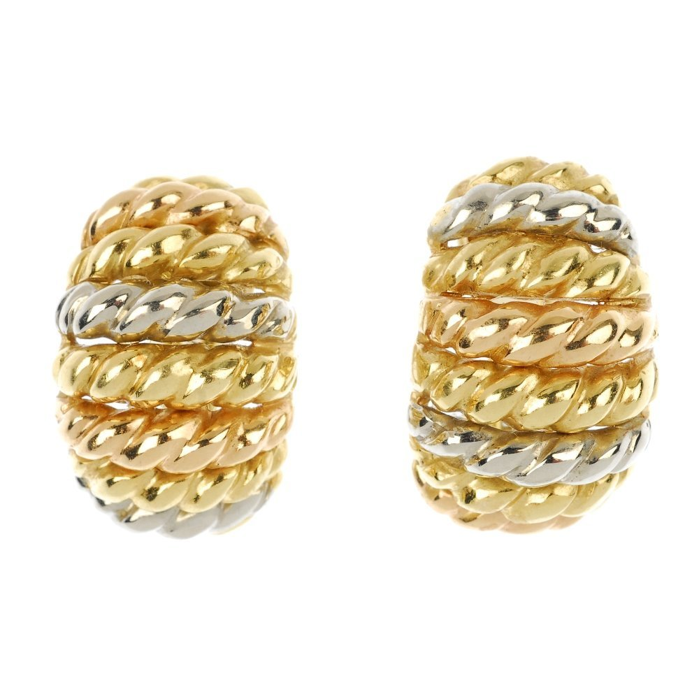 A pair of textured earrings.