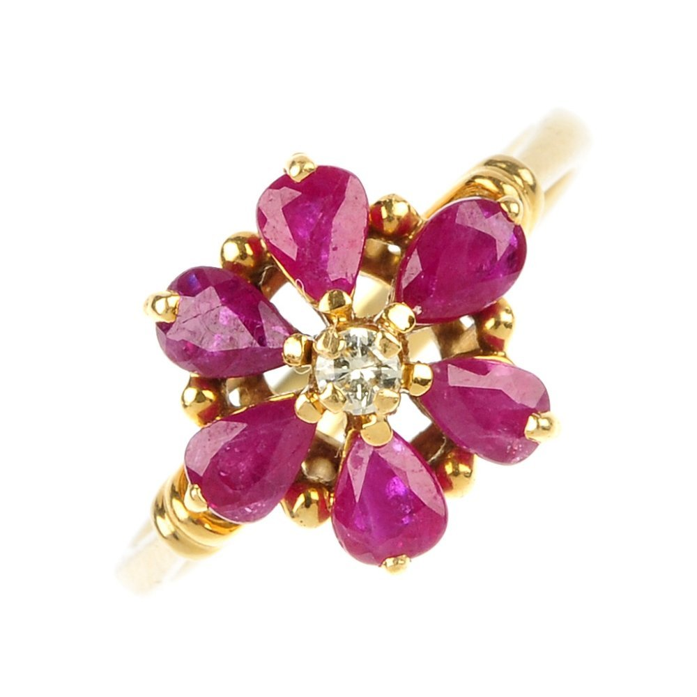 A ruby and diamond floral ring.