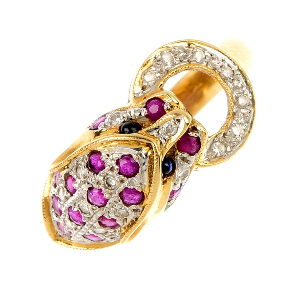 A diamond and ruby leopard ring.